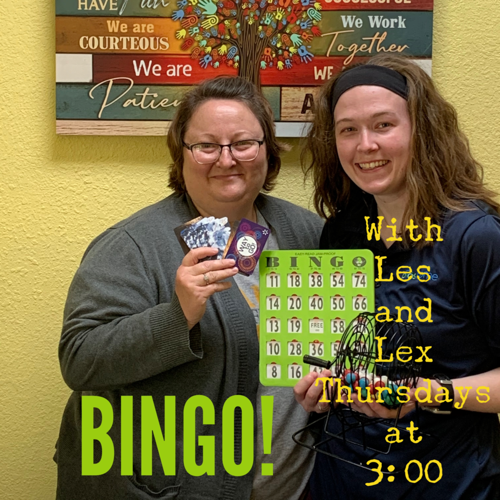 Area Director Leslie and Lexi holding up a bingo card